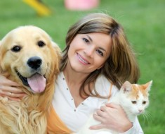 Young woman with dog and cat.